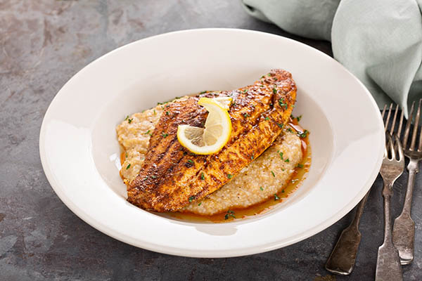 Catfish is an excellent source of protein anytime of the day.  Try this Catfish & Grits dish for breakfast.