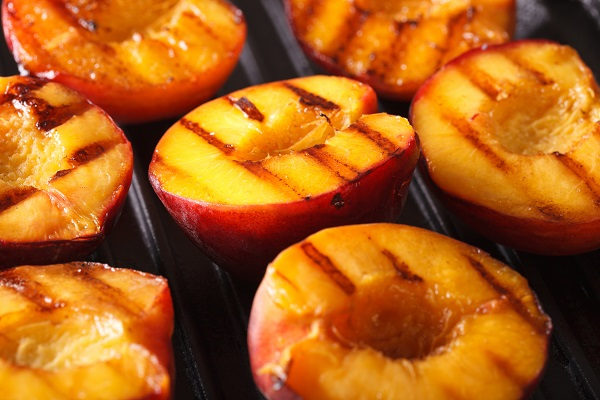 Peaches are great on the grill.  A little olive oil, salt and a few minutes on the grill and they are perfect.